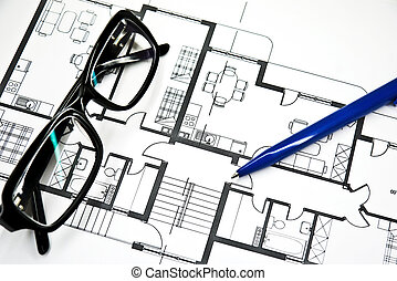plan of apartment with  pencil and glasses