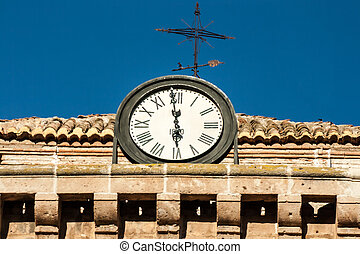 clocktower - Clocktower in almeria spain against a blue sky