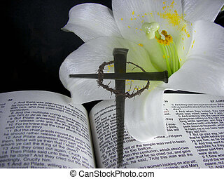 Easter Sunday - Cross of nails and Easter lily on Bible.