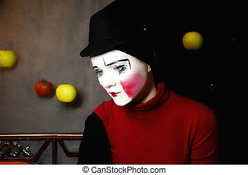 sad mime in a hat with apples - Portrait of the sad mime in...