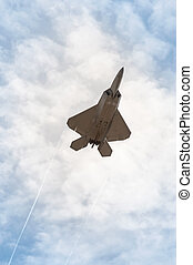 stealth fighter - military stealth fighter speeding through...