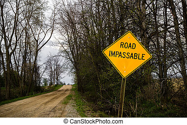 Road Impassable sign indicating a rough road ahead