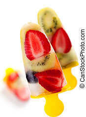 fruit popsicles - frozen strawberry,kiwi,peach and coconut...