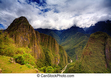 Machu Picchu - Clouds gathering over Machu Picchu in the...