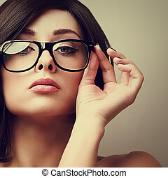 Beautiful sexy woman in fashion glasses looking. Vintage...