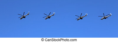 Russian military helicopters fly in formation over Red...