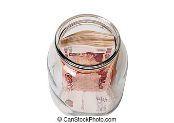 Close-up of russian banknotes (Five Thousand Ruble Notes) in a glass jar