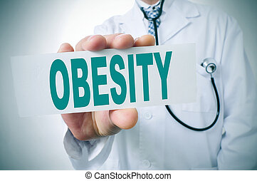obesity - a doctor showing a signboard with the word obesity...