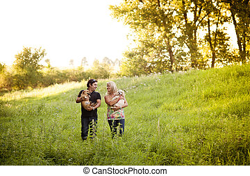 Young couple with dogs - Happy young couple is walking their...