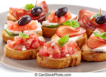 Spanish food tapas Toasted bread with tomato and ham