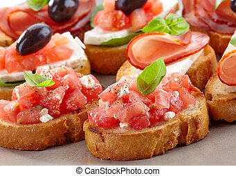 Spanish food tapas. Toasted bread with tomato and ham