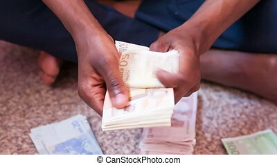 hand counting 50 euro bills - Close up of a african person...