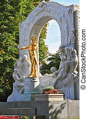 Elegant gilded statue of Johann Strauss, playing the violin...