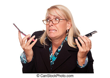 Frustrated Woman with Two Cell Phones Isolated on a White...
