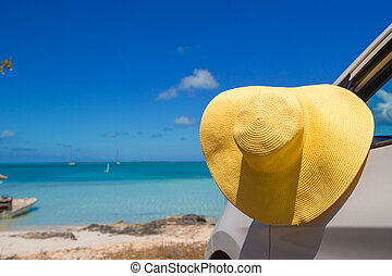 Yellow hat on the car at caribbean island - Yellow hat on...