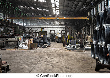 Large industrial interior with aluminium coils