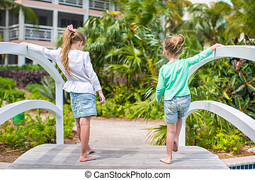Little adorable girls in a beautiful exotic hotel - Little...