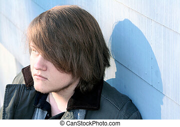 Seriously Thinking - Serious teenage boy in profile,...