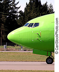 Green airplane nose - Green airplane taxiing on airport...