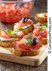 Spanish food tapas Toasted bread with meat and vegetables