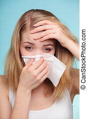 Flu allergy. Sick girl sneezing in tissue. Health - Flu cold...