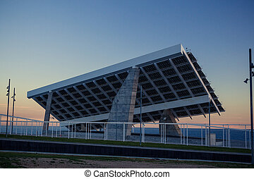 Solar power station against the sunset