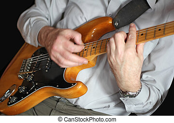 Man playing electrical guitar, closeup image