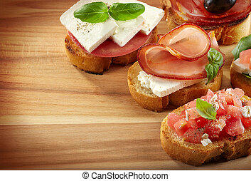 Spanish food tapas. Toasted bread with meat and vegetables