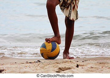 Beach Soccer - Close-up of male foot playing football on...