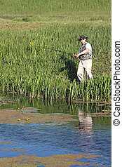 fisherman on river leisure and recreation