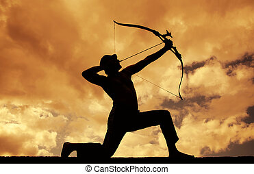 Silhouettes of Archer - Archer aiming at sunset