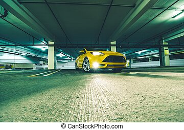 The Parking Space. Yellow Sports Car in Underground Parking...