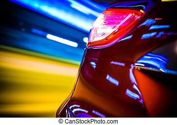 Car Rear Motion Blur. Speeding Modern Car Rear View and...