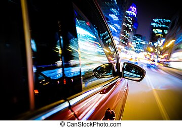Driving Through City Lights. Car Side and Mirror View. Night...