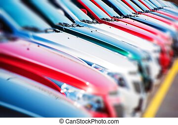 Colorful Cars Stock. Cars For Sale. Dealer Lot Cars Row.