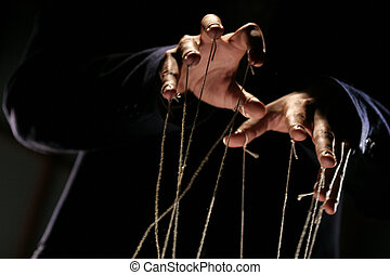 puppeteer - conceptual series: hands of puppeteer with rope