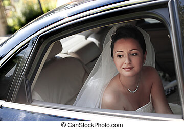 Beautiful bride - The beautiful bride with bouquet in car