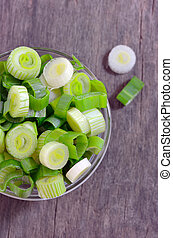 Chopped green onion - chopped green onion in glass bowl...