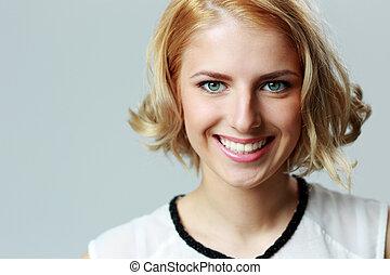 Closeup portrait of a happy smiling woman