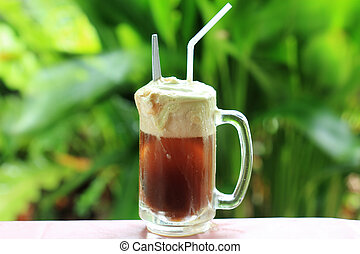 Root beer float a tasty summer treat on Green tree...