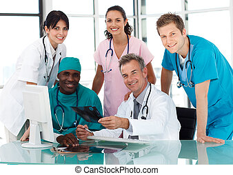 Group of doctors in a meeting looking at the camera
