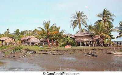 tropical village in jungle. - a run down tropical village...