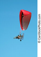 trike paramotor - trike dual paragliding on red wing, clear...