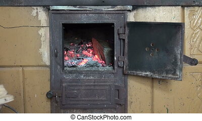 fire in old used furnace fireplace
