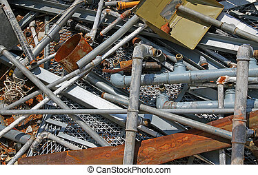 Rusty pipe and more iron and metal material in a landfill of...