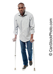 African man with crutches trying to walk