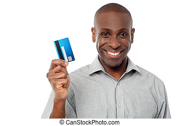 Smiling guy holding credit card - Handsome man showing his...