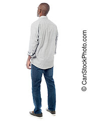 Back view of handsome man looking up - Rear view of young...
