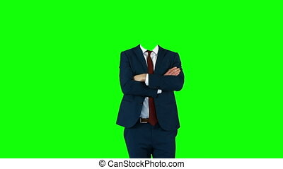 Headless businessman gesturing to camera on green screen...