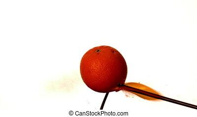 Arrow shooting through orange on wh
